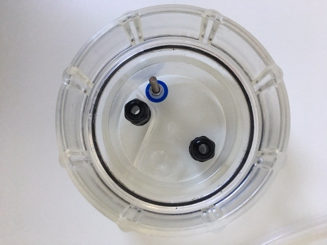 Cholormatic ESC cell head with fittings against a white background.